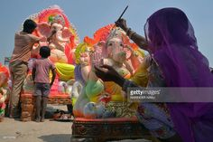 Indian workers put the final touches on statues of the Hindu God Lord Ganesh on the outskirts of Amritsar, ahead of the forthcoming Ganesh Chaturthi festiva.