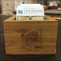 "Oceanside ""fire brands"" its logo and branding onto the front and sides of this compact natural Wood Tray for Glass…"