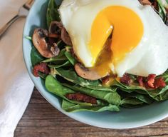 Warm Spinach Salad with Bacon Vinaigrette and a Fried Egg.