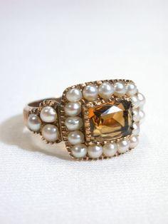 Georgian Citrine Natural Pearl Ring,  22 natural pearls surround a rectangular cur faceted citrine.   circa 1820.