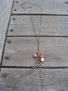Feather Jewelry Skull and Feather Charm Necklace by IvysBoutique, $20.00