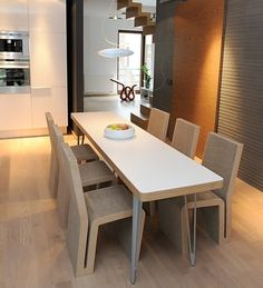 Simple chairs and dining table by Cardboard Concept