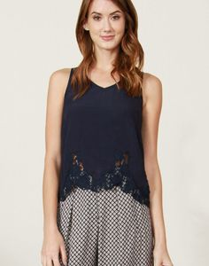 Navy tank with a cool lace trim on the bottom.