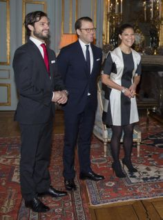 (L-R) Sweden's Prince Carl Philip, Prince Daniel and Crown Princess Victoria, during a reception ahead of Queen Silvia's 70th birthday at the Royal Palace in Stockholm, Sweden, on 18.12.13