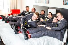 groomsmen in gray with red and black striped socks