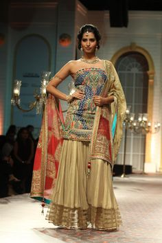 Dazzling use of meenakari work on this design from Mandira Wirk at Amby Valley Bridal Week in Mumbai (Photo: IANS)