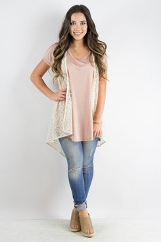 This sleeveless lace cardigan is perfect over just about anything! $34.99 at tyalexanders.com