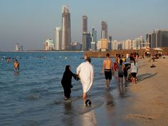 Abu Dhabi City Photos -- National Geographic The warm Persian Gulf waters draw swimmers and strollers.