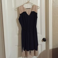 Zara Basic classy dress Pictures do not do justice to this dress! It's beautiful and elegant! The waist is elastic and the material is stretchy. There are no zippers. 100% polyester. Zara Dresses