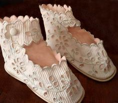 chaussons de bébé--I had a coat and bonnet like this when a baby.  Still have it... exquisite embroidery.