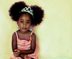 ohhhhh....she is sooo cute.  I love the afro-poofs