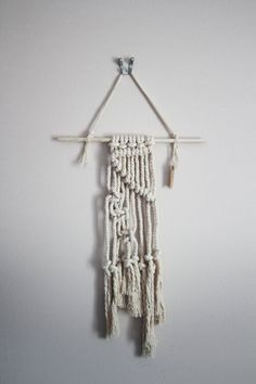 This handmade macrame wall hanging is made from a piece of driftwood from south…