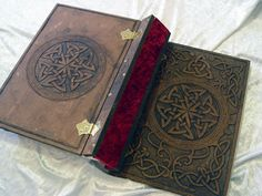 Here is my latest book. It is hand carved MDF finished with paint and oil. All metal work is solid brass. It is based on Celtic knotwork which I designed inside AutoCAD then printed out the design on my A3 printer.
