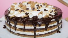 This S'mores Cake Requires No Campfire - or Oven!: This easy no-bake s'mores cake is filled with a rich, toasted marshmallow creme, layers of crunchy graham cracker, and mouth-watering chocolate fudge - also, it's topped with a rich ganache and even Baked Smores, Smores Cake, Campfire Cake, Sweet Recipes, Cake Recipes, Dessert Recipes, Graham Crackers, Marshmallow Creme, Yummy Food