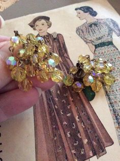 Vintage 1950s Earrings Clip On Yellow Aurora Borealis Glass Crystals Loose Dangly Sparkly by GoodGoodyGirlsJewels on Etsy