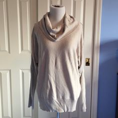 Tan cowl neck sweater Tan DKNYC cowl neck lightweight sweater. Silver toned zippers down the sleeves. Ribbed bottom edge and lower portion of sleeves. 40% viscose/rayon, 35% nylon, 25% polyester. Hand wash cold. 🚫 No Trades 🚫 No PayPal (r) DKNYC Sweaters Cowl & Turtlenecks