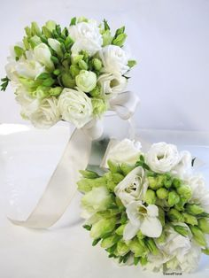 The white roses, lissianthus and freesia's combined with the green roses and freesia buds create a stunningly fresh bouquet. This bouquet is designed by Sweet Floral
