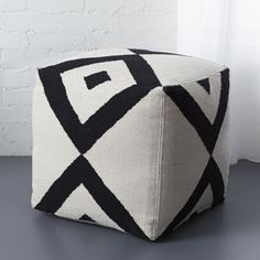 on your mark.  Bold black diamonds link in X effect on handmade dhurrie with ivory cotton-blend background.  Squares up as soft seating or stand-alone ottoman. Cover: Cotton-poly blendShell: 100% cottonZipper closurePolystyrene ball fillSpot clean onlyMade in India.