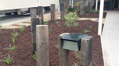 Recycled railway sleepers used as feature posts. Australian native plants with sleeper stepping stones and paths by EcoBuilt Landscaping Brisbane Letter Boxes, Mailbox Ideas, Railway Sleepers, Native Gardens, Internal Design, Outdoor Spaces, Outdoor Decor, Corrugated Metal, Home Landscaping