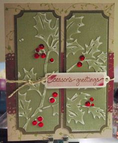 By Celestine1915 at Splitcoaststampers. Christmas holly cuttlebug folder, sanded a bit to accent..sequins and rhinestones added for berries. the background paper was stamped with a little floral leaf. the tag was airbrushed with copic marker.