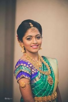 South Indian bride. Gold Indian bridal jewelry.Temple jewelry. Jhumkis.Green and blue silk kanchipuram sari.Braid with fresh jasmine flowers. Tamil bride. Telugu bride. Kannada bride. Hindu bride. Malayalee bride.Kerala bride.South Indian wedding.