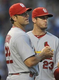 manager Mike Matheny and third baseman David Freese look on after starting pitcher Lance Lynn was pulled during the fifth inning of a game against the Chicago Cubs. Cards lost 2 hotties right there! Cardinals Players, Cardinals Baseball, St Louis Cardinals, Baseball Manager, St Louis Baseball, 3 Strikes, Basketball Uniforms, Basketball Tickets