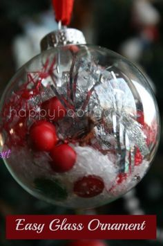 Fill a clear glass or plastic ornament with a few scraps from your craft supplies or christmas supplies.