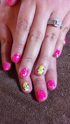Jillian did these Pink Glitter nails with Yellow/Pink flowers - accent ring finger! at Dolce Salon & Spa - Arrowhead