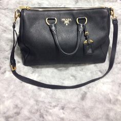 Offers Accepted! ️️  Authentic Prada Daino Calfskin black pebble stone leather! Great condition! Very mild wear. Will show more pics, just ask  Comes with receipt, bag, shoulder strap, authenticity cards, and dust bag! Bag is very beautiful!! Let me know if you have questions! Will consider fair offers :) Can lower via ️️ Prada Bags Shoulder Bags