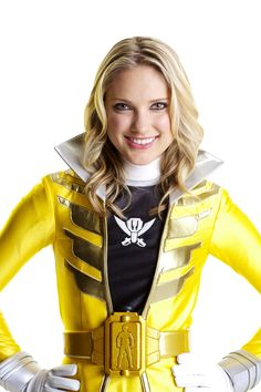 """Gia Moran is also and Super Megaforce Yellow Ranger in Power Rangers Super Megaforce. She is the first yellow ranger since Ashley Hammond to have two Sentai counterparts. Ironically, even though Gia is a tomboyish """"action girl,"""" some of her counterparts (Yellow Turbo Ranger, Yellow Space Ranger, Yellow Time Force Ranger, Jungle Fury Yellow, and Samurai Yellow Ranger) were more feminine in nature."""