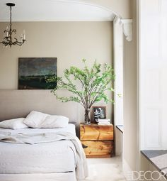11 Enviable Celebrity Bedrooms  Keri Russell  In The Americans star's master bedroom, the headboard fabric and bedding are by Matteo, the sheepskin rug is by IKEA, and the chandelier is an antiques-fair find; Deary made the bedside table, and the walls are painted in Benjamin Moore's Stone Hearth.
