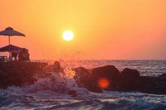Beautiful sunset kissing waves