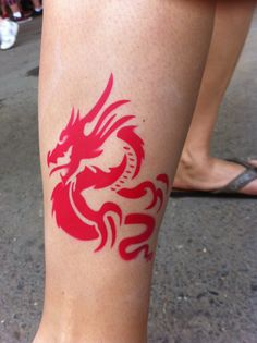 Air-brush tattoo of a red Chinese dragon