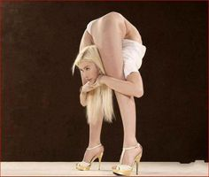 World's bendiest woman Zlata. - Russian girl Julia Zlata, who's able to bend herself into the most improbable shapes has broken several world records for her unbelievable flexibility.