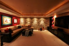 Music / Media Room, Home Theater, Stone Wall feature, recessed lighting, guitar decor, TV room, family room