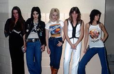 The Runaways . Backstage at Cobo Arena , opening for Rush in February of 1977 . DETROIT - FEBRUARY 10: Rock group The Runaways (L-R) Lita Ford , Joan Jett , Cherie Currie , Sandy West and Jackie Fox . Photo by Michael Marks