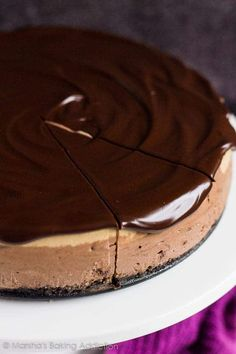 Layered Mocha Cheesecake - An Oreo crust topped with a deliciously creamy chocolate cheesecake layer, a coffee cheesecake layer, and dark chocolate ganache! Mocha Cheesecake, Chocolate Cheesecake, Cheesecake Recipes, Dessert Recipes, Chocolate Ganache, Vegetarian Chocolate, Chocolate Recipes, Oreo Crust, Coffee Dessert