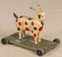 Walter Gottshall, carved and painted goat pull toy, signed and dated 1981, 7 1/2'' h., 9'' l. - Price Estimate: $75 - $150