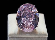 "Most Expensive Gem in the World: the Pink Star Diamond The Pink Star Diamond is a ""Fancy Vivid Pink"" diamond that was mined in 1999 in South Africa. Weighing in at carats, this gem was sold by. Miranda Kerr, Types Of Opals, Rare Gemstones, Pink Stars, Diamond Gemstone, Diamond Jewelry, Rocks And Minerals, Diamond Are A Girls Best Friend, Black Diamond"