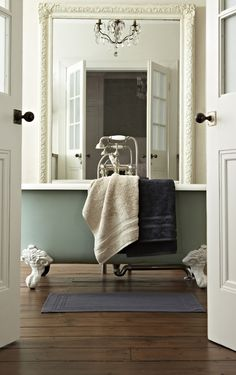 A luxurious bathroom ~ Love the claw foot bath, mirror & chandelier <3
