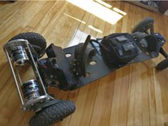 Electric Mountainboard with printed motor mounts,enclosures and pulleys by - Thingiverse Longboard Design, Skateboard Design, Diy Electric Skateboard, Drop Through Longboard, Karts, Jeep Liberty, Go Kart, Pulley, Electric Cars