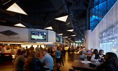 Cascade Coil drapery lines the courtside bar at Barclays Center with shimmering elegance.