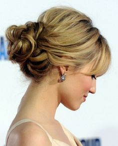 Bridal hairstyle elegant curly bun with fringe great for long and curly hair