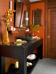 Mahogany + Pumpkin + Ebony :Deep, rich earth tones give this bathroom a masculine edge. The room's color scheme was designed to blend with its existing woodwork, which features a warm mahogany stain. To temper the small bathroom's predominantly dark color scheme, the vanity features a furniture-like, open construction.