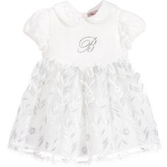 Baby girls lovely ivory dress by Miss Blumarine, featuring a soft, silk velvet bodice with the designer's sparkling diamanté logo on the front. With little velvet bows on the waistline, the skirt has a gorgeous organza overlay, embroidered with ivory and silver flowers, with a glittery tulle layer below. Fully lined, the puffed sleeves have elasticated cuffs and there is a button fastener at the back.