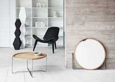 Hans J Wegner's reversible tray table updated with smoked oak surfaces.