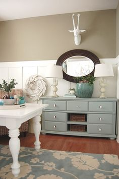 Love the colours... Pretty color scheme: walls behr village square, wainscoting bm simply white, bureau sw halcyon green 6213, which is more of a robin's egg blue. But get that fake animal head off the wall. =P Should I paint my desk white? Hmmm