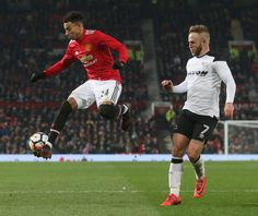 Jesse Lingard of Manchester United in action with Johnny Russell of Derby County during the Emirates FA Cup Third Round match between Manchester...