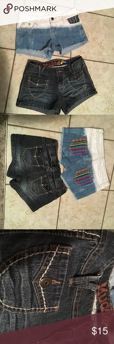Two pair size 0 jean shorts Mudd and Hot Kiss Two pair size 0 jean shorts. Mudd darker denim with front pockets and back pockets.  Other pair is multi colored kind of an hombre effect of faded white then light blue then shade darker of blue. Back pockets and one front pocket have cute embroidered material multi color design. Different areas of faded blue all over made like that. Both used but still in great condition mudd and hot kiss cici short Shorts Jean Shorts