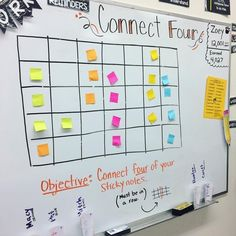 Each group had a cup filled with ten review questions based on what we've learned in math this year. The students worked together to solve the questions one at a time. If they got the right answer, they got to go place one of their sticky notes on the boa